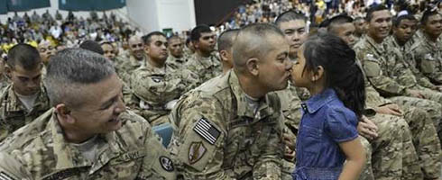 Guam_Guard_Kissing_Daughter.jpg