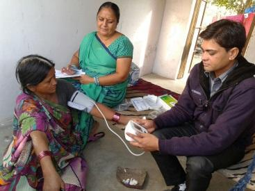 SEVAK (helper) Jayeshbhai doing a Blood Pressure Screening in Indiranagar, Ahmedabad