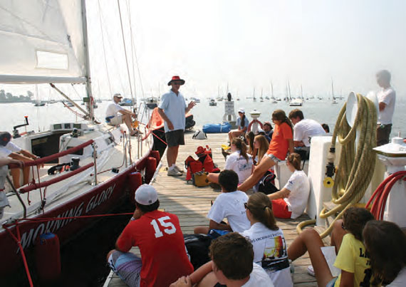Safety at Sea Chairman Rich du Moulin works with junior sailors during one of many Junior Safety at Sea Seminars held by the Storm Trysail Foundation