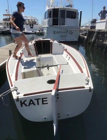 Kelsey Britton, an instructor at the IYRS School of Technology & Trades, steps aboard the lovingly restored Kate.