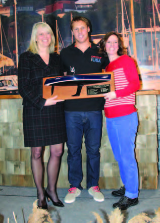 Janet Coit (left), Rhode Island Department of Environmental Management Director, presents the John H. Chafee 2014 Boater of the Year award to Rome Kirby. Also pictured is Wendy Mackie (right), CEO of RIMTA. Photo courtesy of the Providence Boat Show