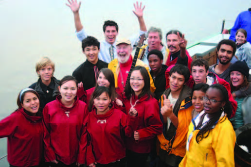 Pete Seeger (1919 - 2014) touched countless lives through his music, his kindness, and his work towards a better, more just world. He's pictured here the deck of the sloop Clearwater with Inuit students from Uummannaq, Greenland in 2010. © Chris Bowser