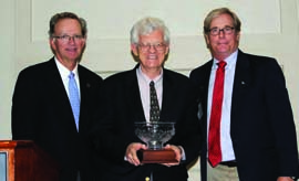 US Sailing President Thomas Hubbell (left) and Rich Jepsen, US Sailing's Training Committee Chair (right) present the Timothea Larr Award to John Rousmaniere. © US Sailing