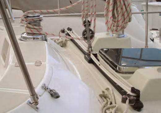 This seriously poor lead of the mainsheet, again on a name brand yacht, is just nuts. The capacity for the traveler car to slide is limited by the radius of the distance between the car and the winch. Functionally when going upwind, the traveler is NOT adjustable.