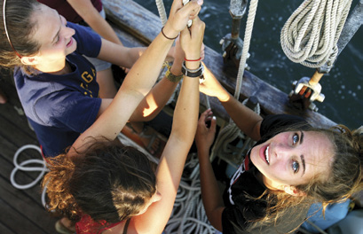 Sisters Under Sail participants haul away aboard the Tall Ship Unicorn