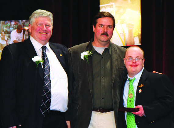 Eric Donch (center) receives an Unsung Hero Award from Beau Doherty, President of Special Olympics Connecticut (left) and Ryan Paggioli, Special Olympics Athlete at the 2013 Special Olympics Connecticut Hall of Fame Dinner. © soct.org