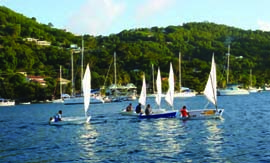 These sailors practicing on Admiralty Bay are just of few of more than 200 that have been through the Bequia Youth Sailors program. © bequiayouthsailors.org