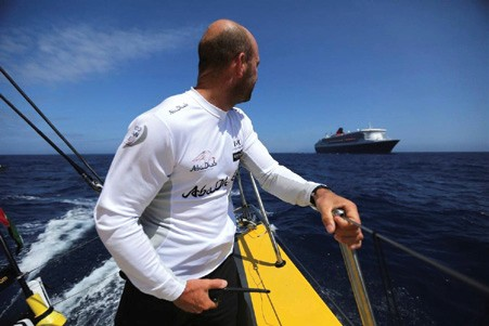 Volvo Ocean Race skipper Ian Walker looks back as RMS Queen Mary 2 overtakes Abu Dhabi Ocean Racing's Volvo Ocean 65 Azzam in the Atlantic.  © Matt Knighton/Abu Dhabi Ocean Racing