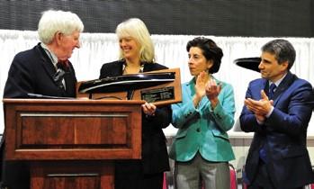 Bart Dunbar (left) receives the RIMTA Boater of the Year Award.