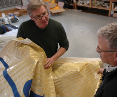 UK Sailmakers New York loft owner Dave Coughlin (left) discusses sailcloth with Tom D'Albora of Dimension-Polyant.
