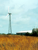 Farm landscape with small wind turbine