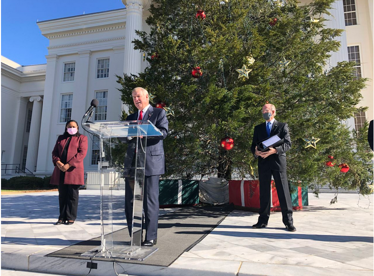 Former Montgomery Mayor Todd Strange speaks at a news conference at the Alabama Capitol about the report from Gov. Kay Ivey's Study Group on Gambling Policy. Elizabeth Huntley, left, and Young Boozer, were among other study group members on hand. Boozer holds the 800-page report.