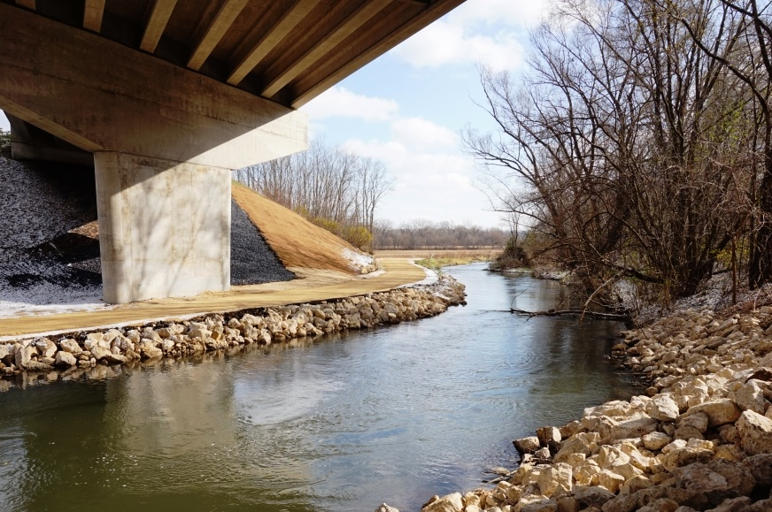 Stream repair on the bridge viaduct piers and restored the sloped embankment under the USH 14 underpass after the August 2018 flood.