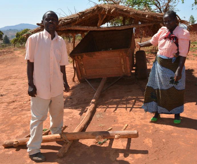 Harriet_Mwandira_showing_off_an_ox-cart_bought_from_family_farming_business_690_resized.jpg