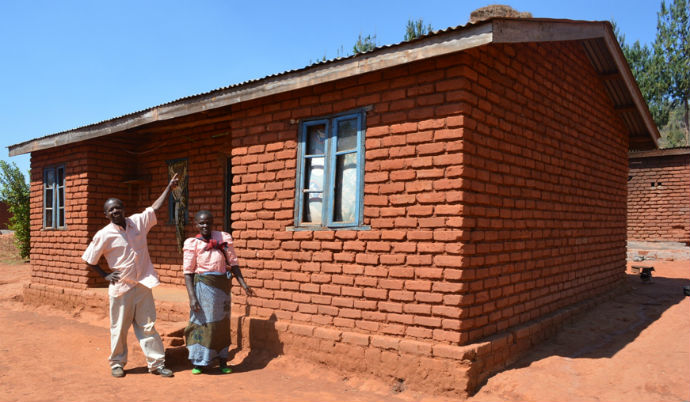 Mwandira_and_wife_showing_their_house_built_from_family_farming_proceeds_690_resized.jpg