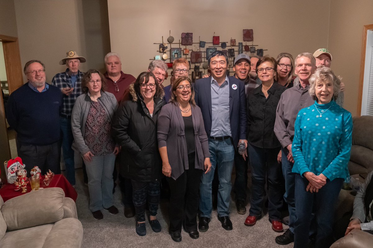 Andrew Yang in a living room with gathered supporters