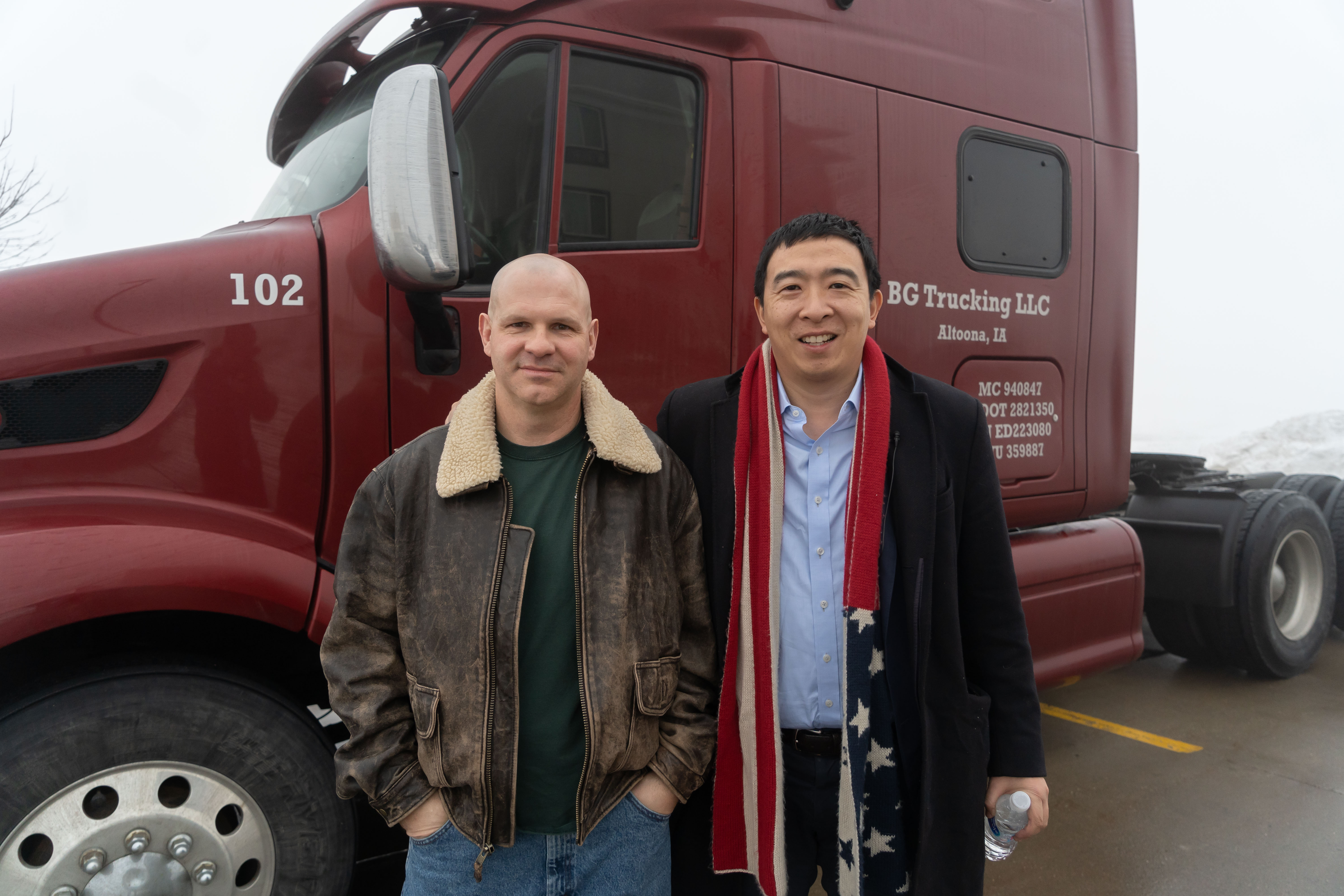 Andrew Yang and Dennis Bogaski, an Iowa-based truck driver, stand in front of Dennis' truck