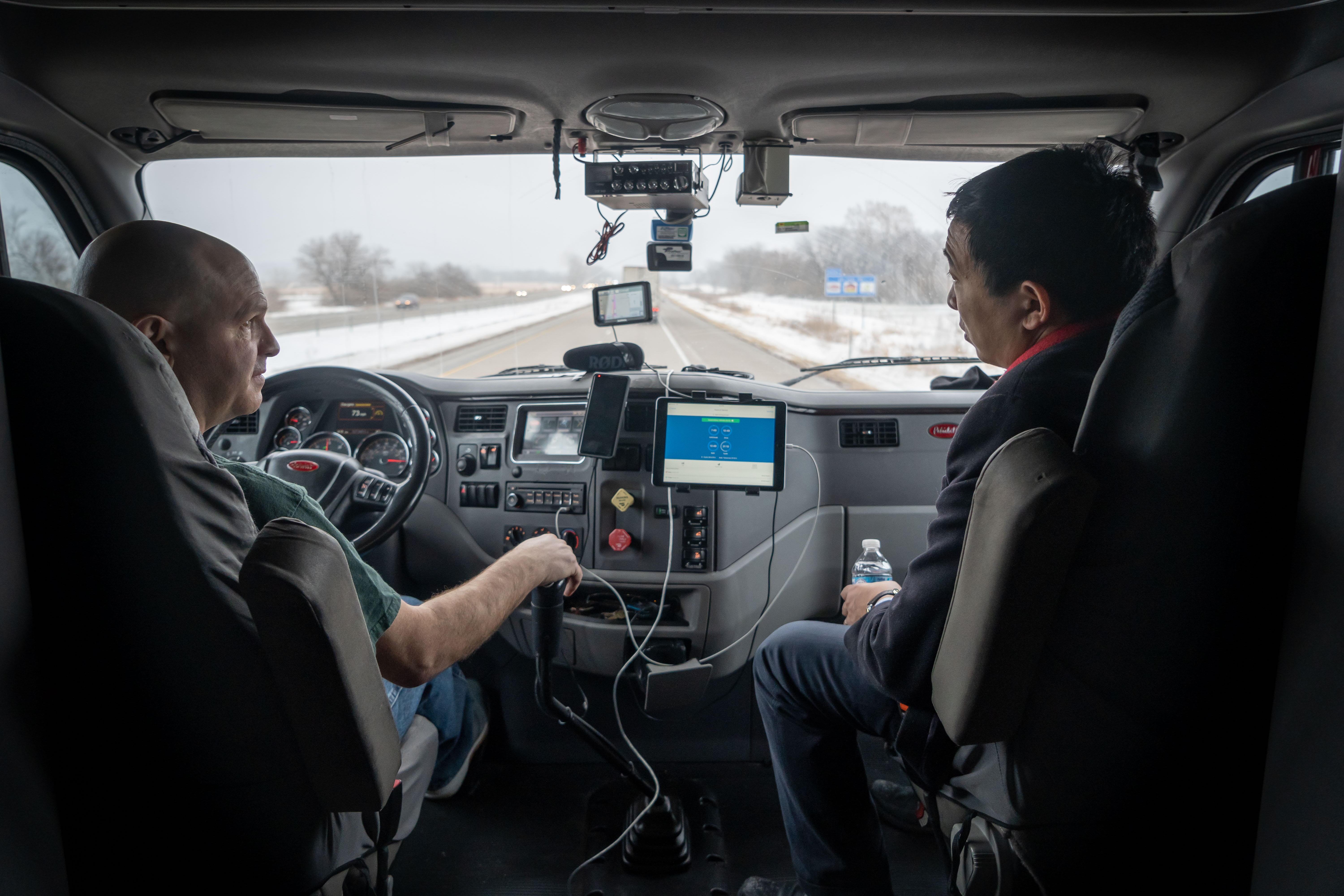 Andrew Yang and Dennis Bogaski, a truck driver, talk while Dennis drives Andrew in his truck