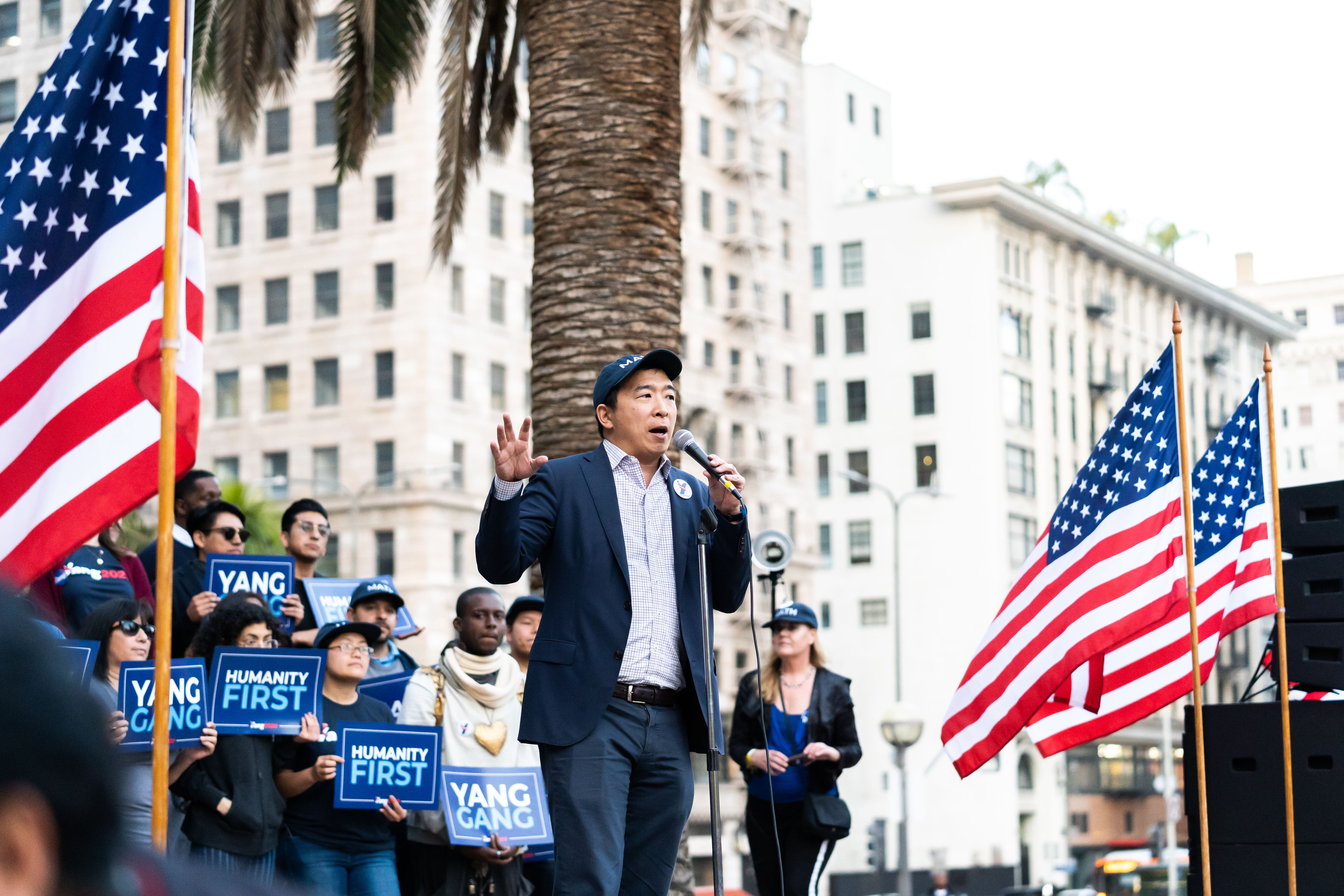 Andrew Yang talks about his policy platform in front of a crown in LA