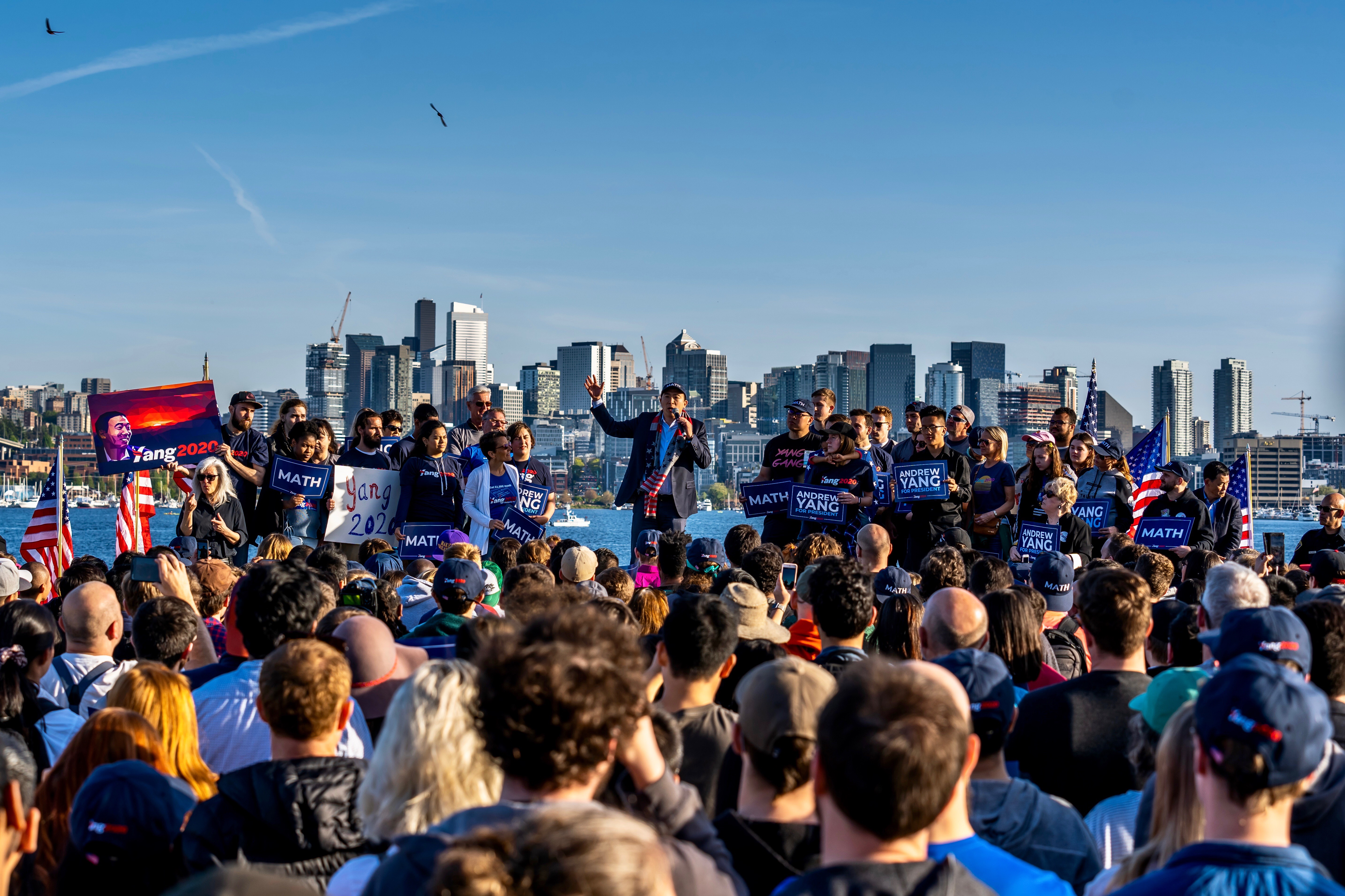 Andrew Yang, with Seattle in the background, delivers a speech to supporters