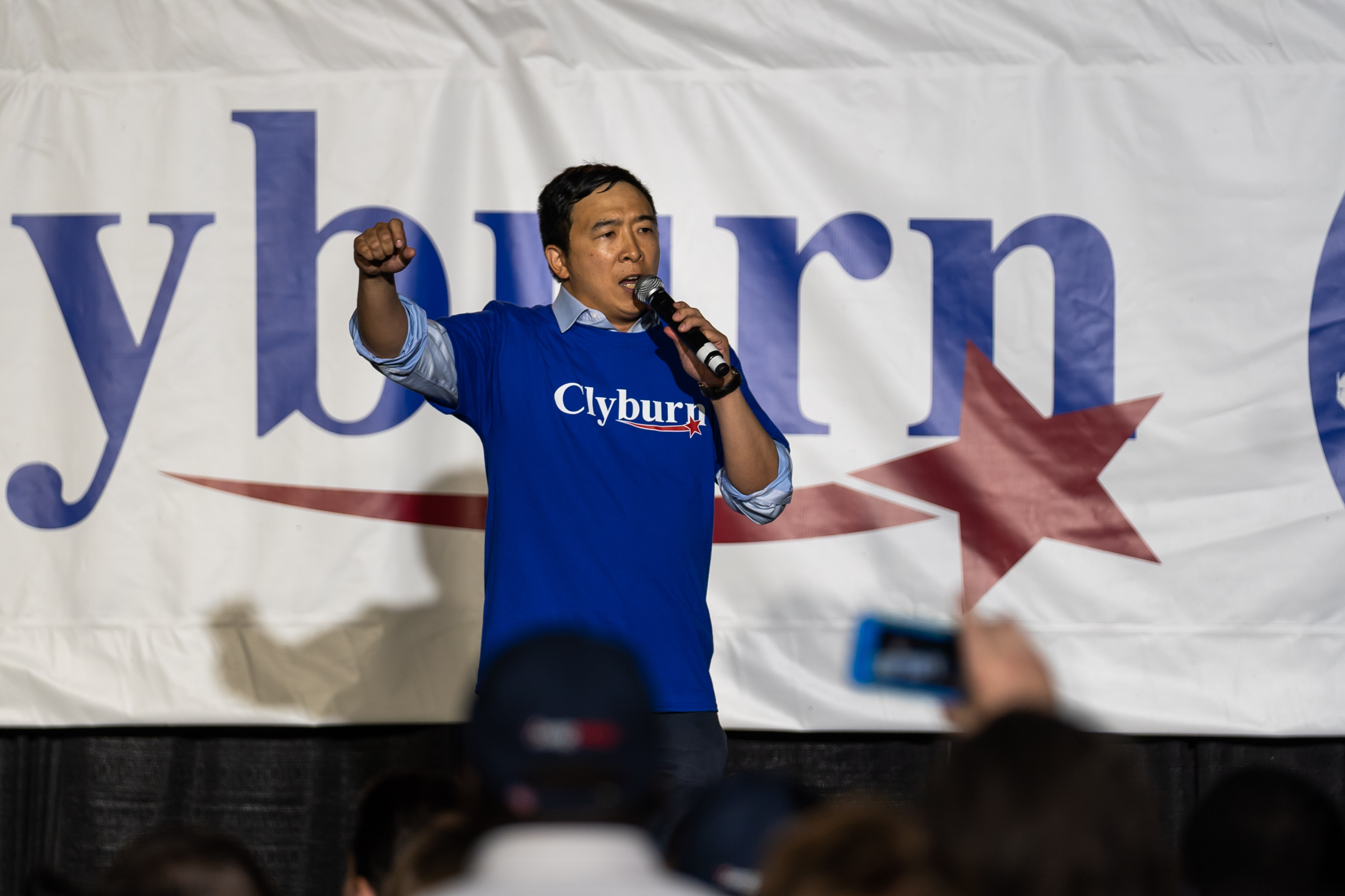 Andrew Yang delivers a speech on the stage of Rep. Clyburn's Fish Fry in South Carolina