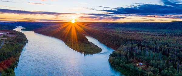 Aerial view of a river landscape in northern B.C. at sunset