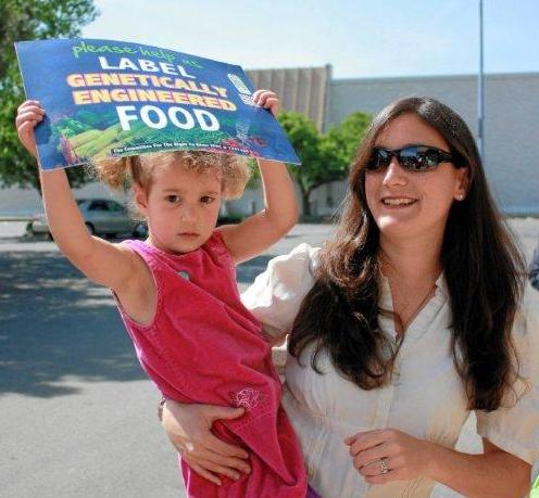 Mom_and_Girl_with_Label_GMOs_sign_cropped.jpg