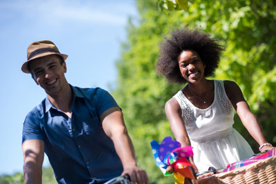 young-multiethnic-couple-having-a-bike-ride-in-PPE96DD.jpg