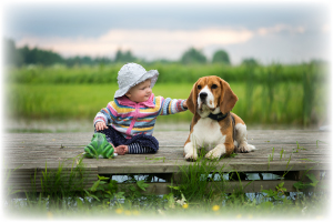 baby-girl-and-beagle-dog-ZVXQYTW.jpg