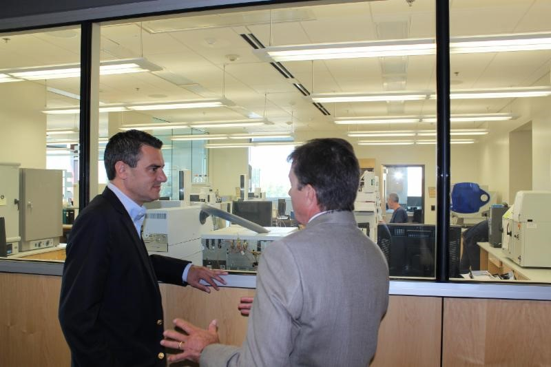 (Congressman Yoder And Director Allen Hamm On A Tour Of The Crime Lab In  Olathe.)