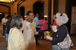 Amy (center) talks with attendees at a caregiver appreciation luncheon in Myrtle Beach SC