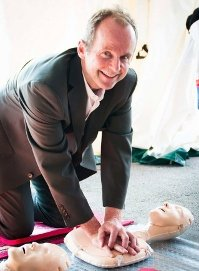 Man practicing CPR on a manikin