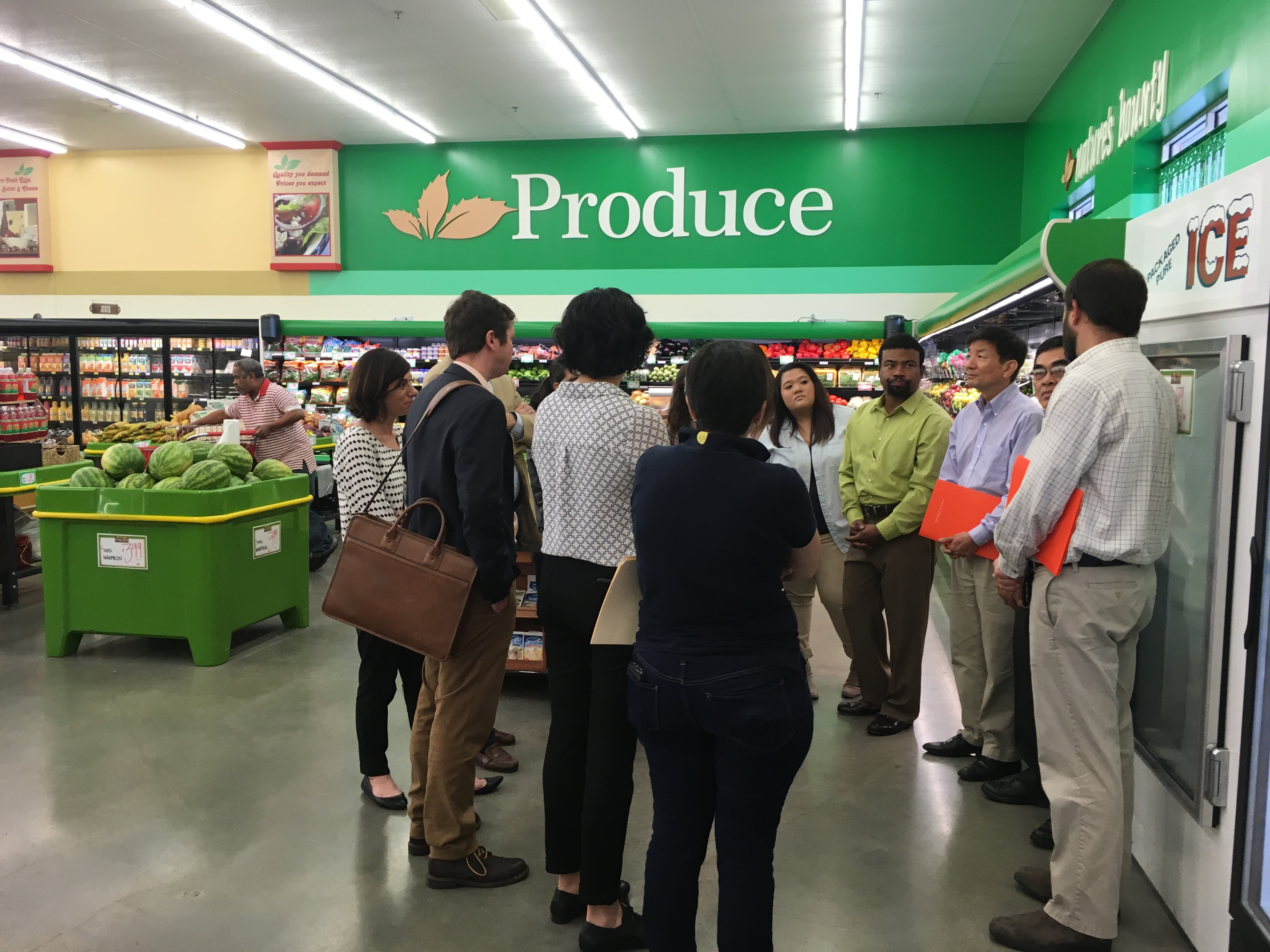 Group gathering in grocery store