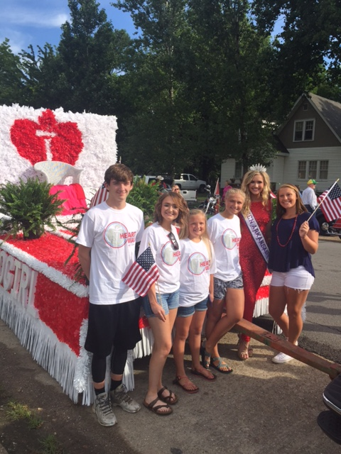 Advocates in front of an A.H.A. float