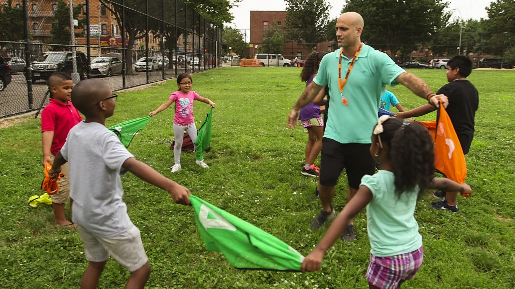 Children with their PE Teacher.
