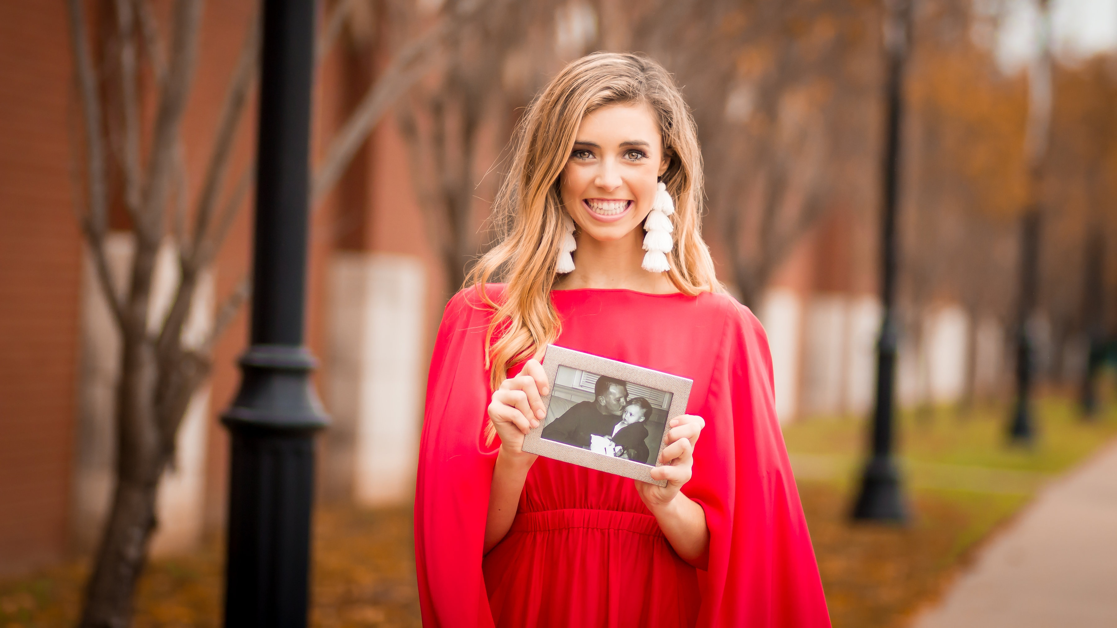 Abby Davis holding a photo