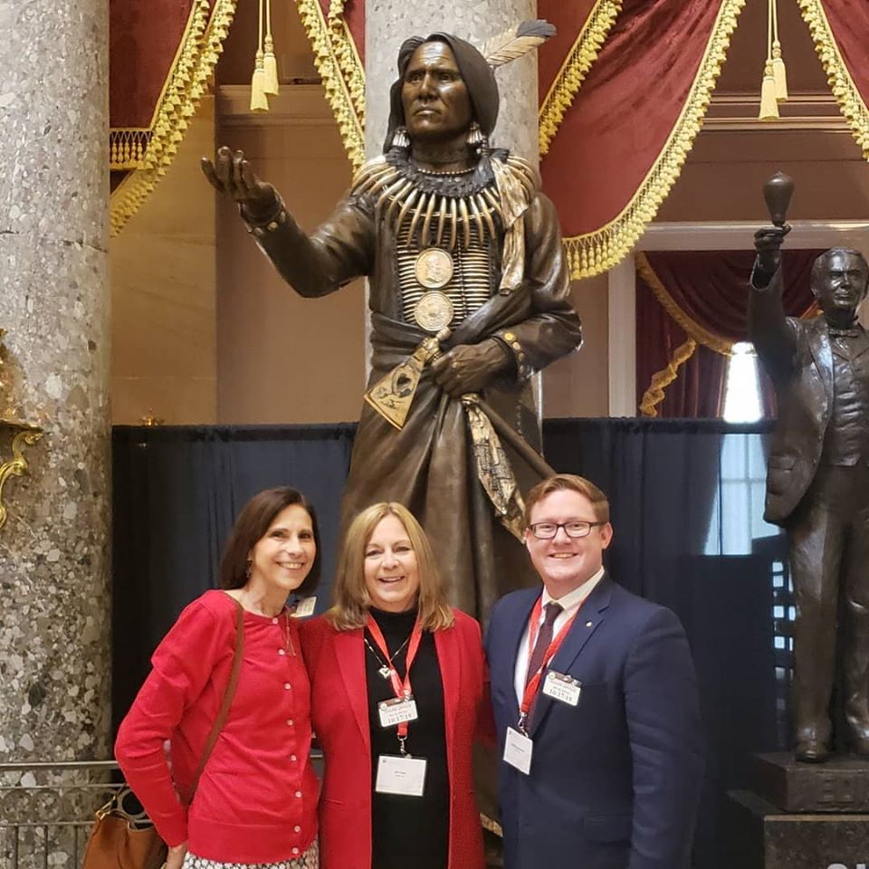 With a statue of Standing Bear