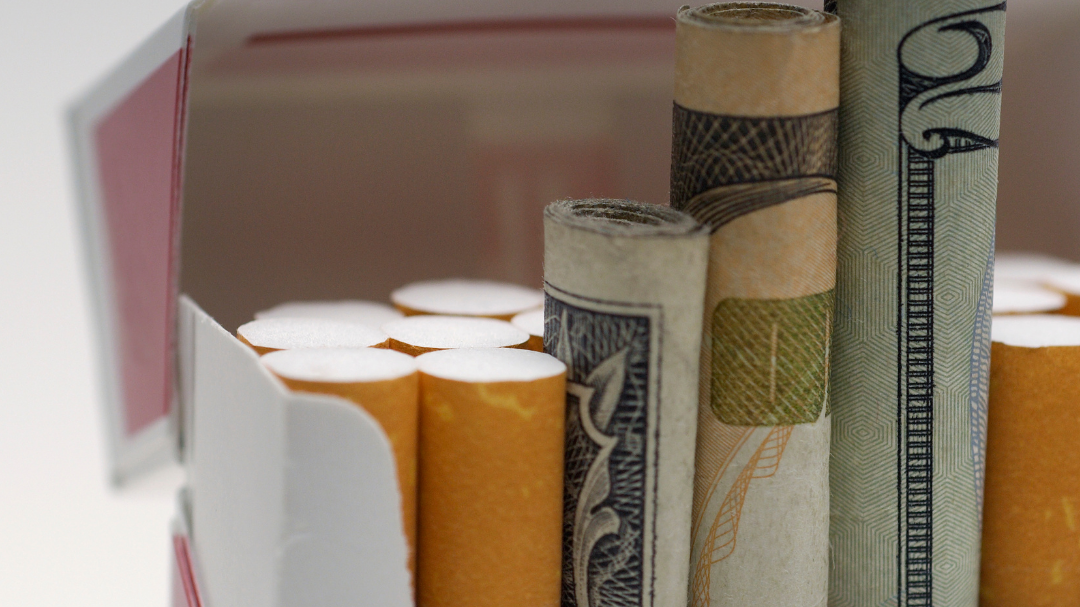 A pack of cigarettes with money inside the pack