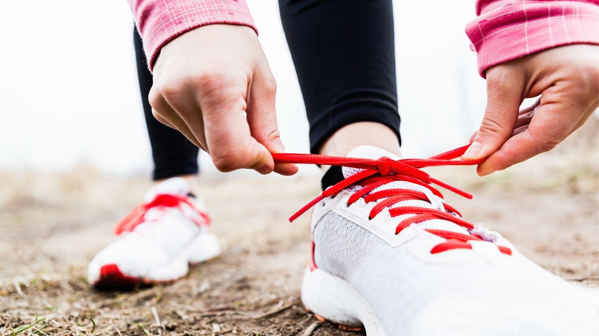 person tying shoe