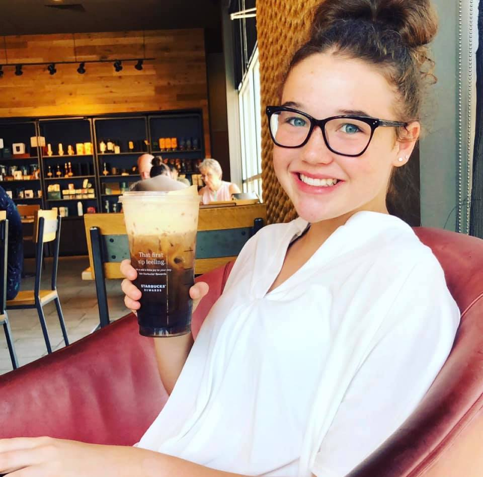 Picture of Tori with a coffee