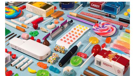 A graphic of candy and e-cigarette devices mixed together on a table