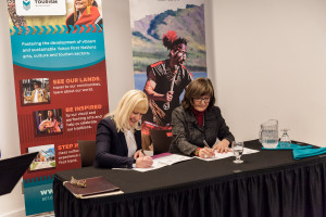Minister Elaine Taylor and Yukon First Nations Culture and Tourism Association president Shirlee Frost sign a new increased funding agreement in March.