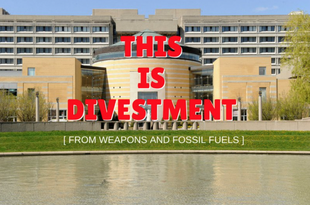 """An image of Vari Hall on a summer day with the caption, """"This Is Divestment [from weapons and fossil fuels]"""""""