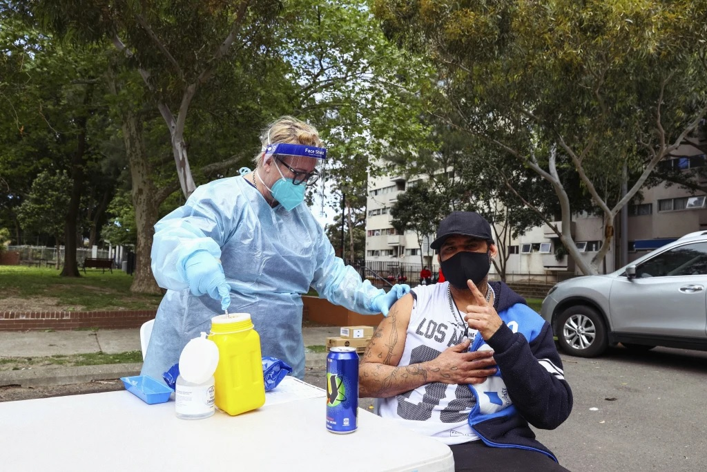 Raymond King gets his COVID-19 jab at the pop-up clinic set up at the Waterloo social housing estate in Sydney's inner south.